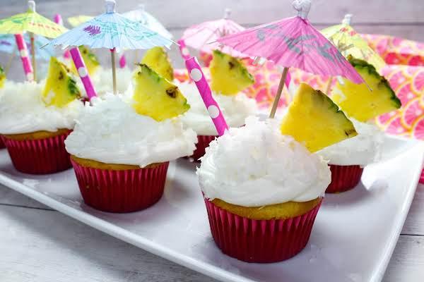 A Tray Of Pina Colada Cupcakes.