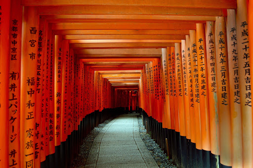 Fushimi Inari-taisha, a stunning Shinto shrine in Kyoto. These gates lead to a pathway to explore the smaller shrines on the site.