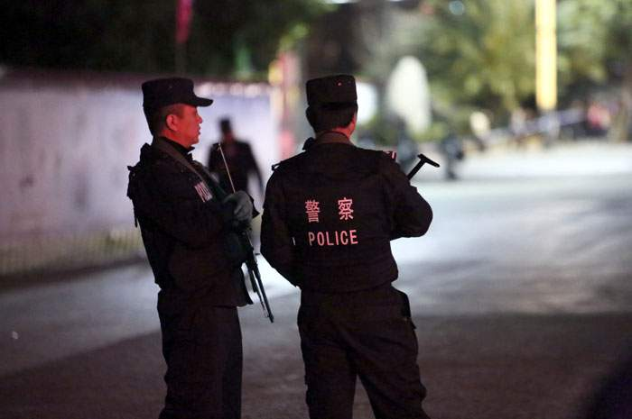 March 2014: Police in Kunming on patrol after the killing of 31 people