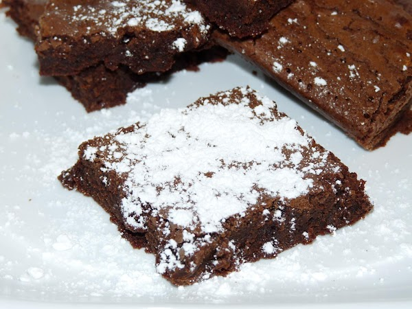 Let cool before cutting into squares. Serve with powdered sugar if desired!