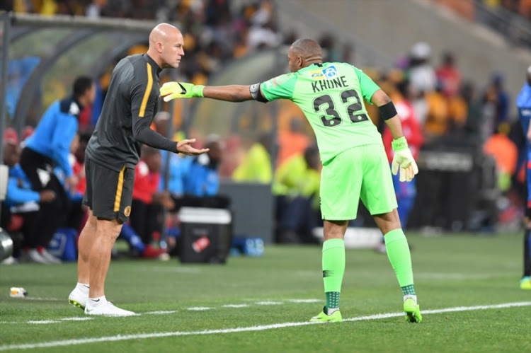 Goalkeeper coach Lee Baxter and Itumeleng Khune during the MTN 8, semi final 2nd Leg match between Kaizer Chiefs and SuperSport United at FNB Stadium on September 01, 2018 in Johannesburg, South Africa.