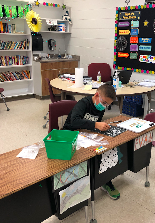 5th Graders Working on Science Experiments