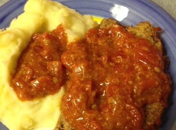 Serve over meat loaf and mashed potatoes.  =^..^=