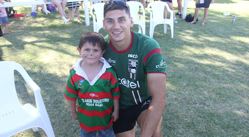 Tyson Crean with South Sydney Rabbitohs NRL player Kyle Turner on Friday afternoon at Hogan Oval at the NRL Roads to Regions tour visit