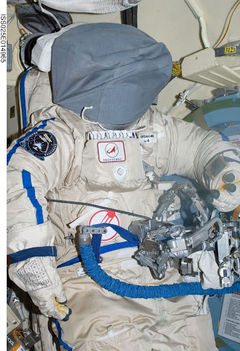 A Russian Orlan spacesuit was photographed by an Expedition 25 crew member in the Pirs Docking Compartment of the International Space Station.