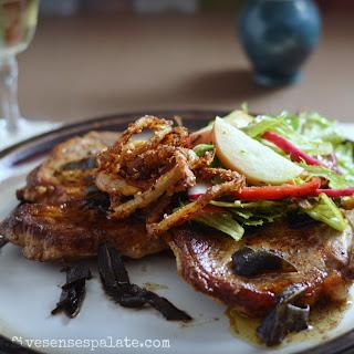 Pork Steak with Sage Butter, Apple Salad & Crispy Onions.