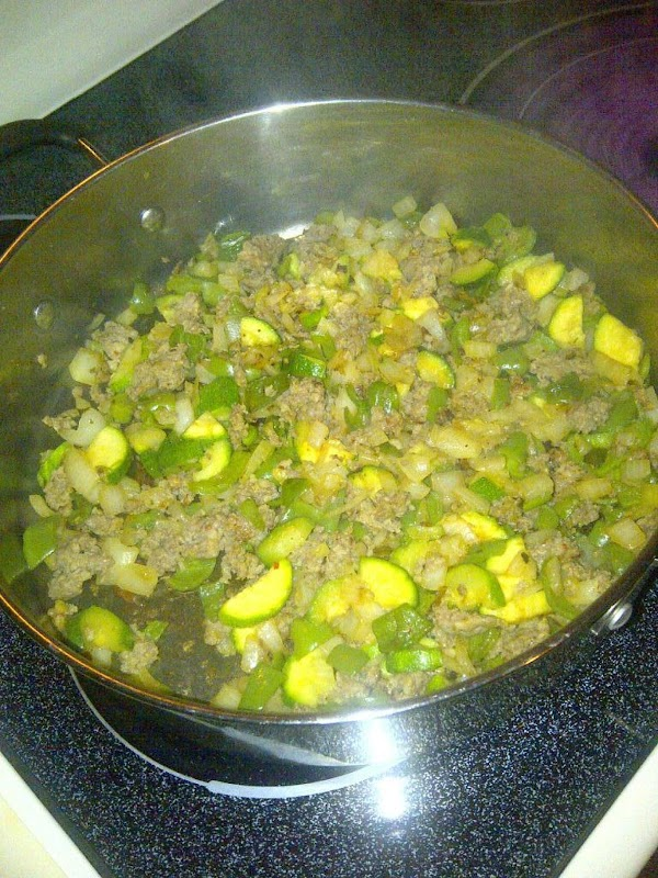 Cook on high/medium heat all together the Italian sausage, chopping it well, onion, green...