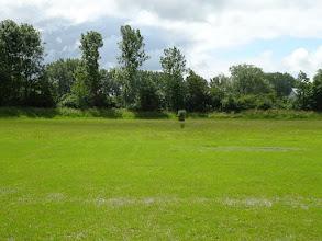 Photo: Door de vele regenval van de voorgaande dagen is het drassig nat op het terrein.