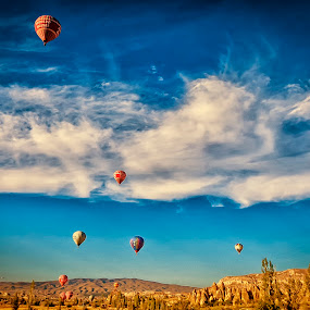 Floating over Cappadocia by Rafael Uy - Landscapes Travel ( hot air balloon, afternoon, goreme, floating, turkey, balloon, cappadocia )