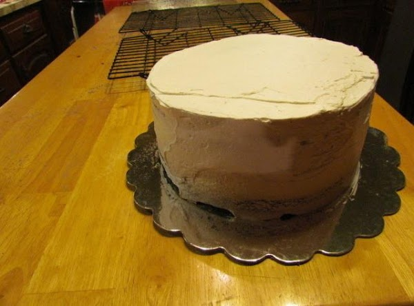 """Take the rest of your whipped cream frosting and """"cap"""" off your cake making..."""