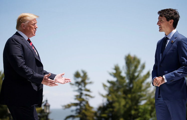 US President Donald Trump approaches Canada's Prime Minister Justin Trudeau as he arrives at the G7 Summit in Charlevoix, Quebec on June 8 2018. Picture: REUTERS/LEAH MILLIS