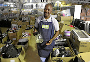 SPIN CYCLE:  Mthunzi Qagana specialises in fixing broken appliances  Picture: Ruvan Boshoff