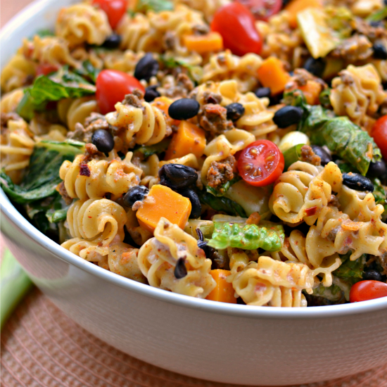 Easy Taco Pasta Salad Brings Taco Seasoned Ground Beef, Pasta, Tomatoes, Black Beans, Cheddar And Scallions Together Into A Creamy Slightly Spicy Easy To Pull Together Ranch Dressing.