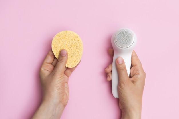 Facial brush or face sponges choice concept Premium Photo