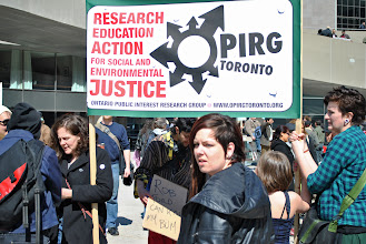 Photo: The OPIRG contingent proudly displays their new banner.
