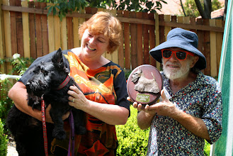 Photo: Desley being presented with the President's Award for her help in rescuing the QLD Scotties. She's holding one of the rescues dogs.