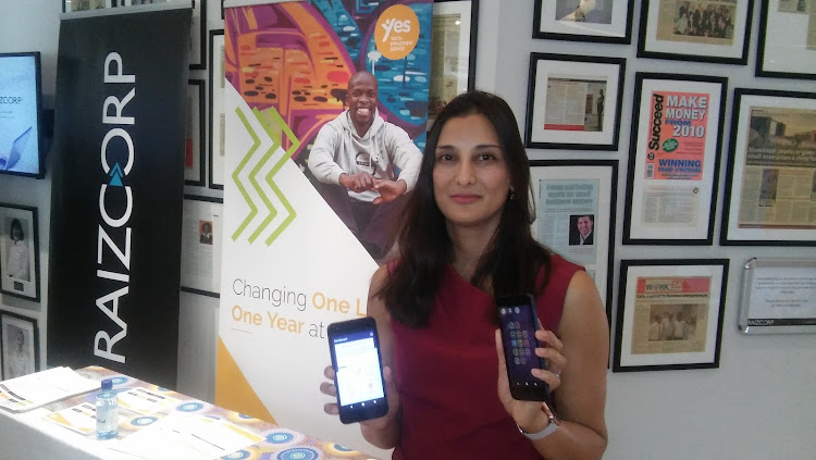 Tashmia Ismail-Saville the CEO of Yes, with the phone's used to monitor youth during their internships.