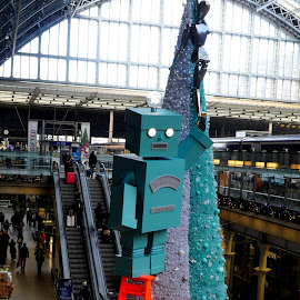 Robot and Tree by DJ Cockburn - Public Holidays Christmas ( fragrant, london, britain, christmas tree, stairs, winter, advertising, perfume, building, interior, robot, uk, public holiday, glass ceiling, railway, decoration, architecture, england, art, escalator, railroad, festive, statue, step ladder, sculpture, st pancras station, christmas, steps, people, tiffany & co, marketing, travel )
