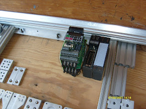Photo: Siemens Micromaster 3212 motor control w/out the case + some Mitsubishi PLC modules