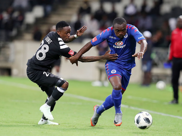 SuperSport United striker Richard Kissi Boateng (R) dribbles past Mthokozisi Dube of Orlando Pirates during the Absa Premiership 2017/18 match at Mbombela Stadium, Johannesburg on 11 April 2018. The match ended 0 - 0.