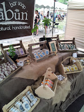 Photo: Soapy Soap Company Booth Displaying Wrapped Soaps.