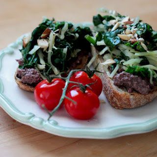 Garlicky Greens Bruschetta With Olive & Almond Tapenade