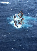 Photo: The HMS Bounty, a 180-foot sailboat, is shown submerged in the Atlantic Ocean during Hurricane Sandy approximately 90 miles southeast of Hatteras, N.C., Monday, Oct. 29, 2012. Of the 16-person crew, the Coast Guard rescued 14, recovered a woman and is searching for the captain of the vessel. U.S. Coast Guard photo by Petty Officer 2nd Class Tim Kuklewski.