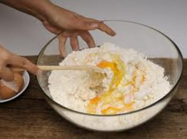 Stir water, oil, and eggs in medium bowl until blended. Gently stir in muffin...