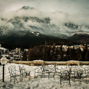 No one sitting by Iulia Georgescu - Landscapes Mountains & Hills ( cityview, mountains, fog, chairs, snow, table, palace )