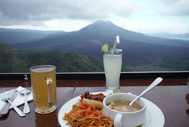 eating out in bali with a view of a volcano women travel