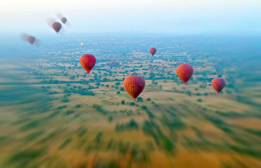 Myanmar-balloons.jpg - Hot air balloons sail over Bagan, Myanmar.