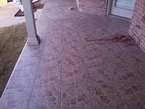 Photo: 16x16 outdoor tile W/ metal edging & sandpaper finish
