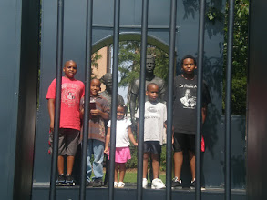 Photo: the kids between the jail bars....