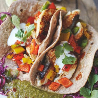 Jamie Oliver's tasty fish tacos with game-changing kiwi, lime and chilli salsa.