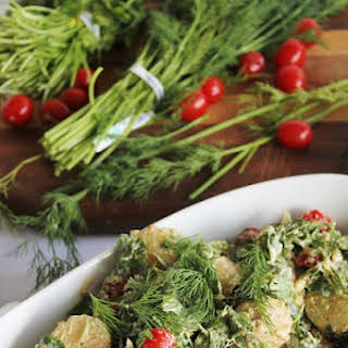 Potato Salad With Cilantro, Dill, Tomatoes + Raw Mayo.