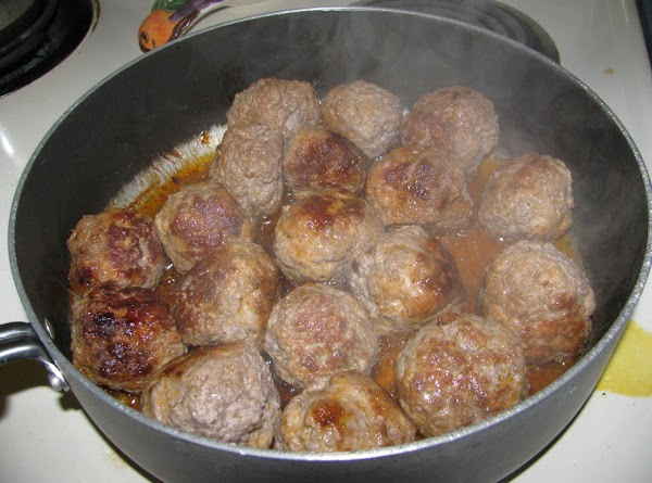 Combine hamburger and sausage, form into meatballs and cook. Cover and keep warm.