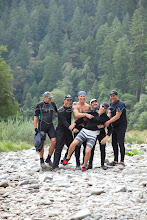 Photo: Group of men posing for portrait while on a white water rafting trip along the wild and scenic Rogue River in southern Oregon.