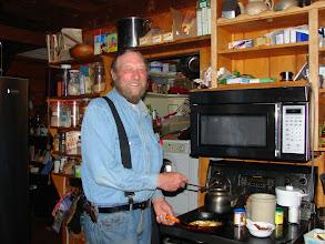 Photo: Mike Lemon cooking breakfast.