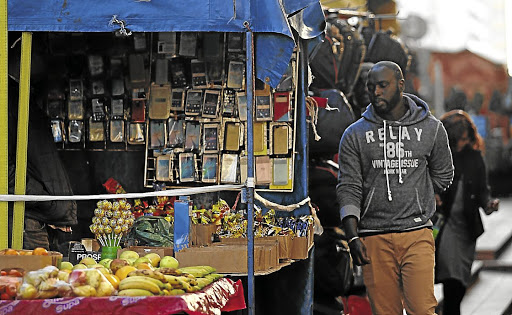 Hand to mouth: The GDP contribution by sub-Saharan Africa's informal sector has fallen to 38% from nearly 45%, the IMF says. Up to 90% of jobs outside agriculture are in the informal sector. Picture: THE HERALD