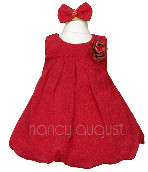 Photo: Red Chiffon Infant Dress with Balloon Skirt: This red chiffon infant dress speaks for itself. It's all about putting your infant in a fun and sassy dress. You're smile will stretch from left to right when you see your little infant girl and her sister put on matching dresses for Christmas holiday pictures this season. This lightly textured chiffon dress is made with care and is soft to the touch so that the youngest of infant girls can be comfortable while looking her best.