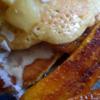 Coconut Pancakes, Cinnamon Pineapple Syrup & Caramelized Plaintains With Rum Ricotta Whipped Cream
