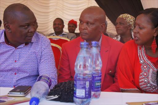 Ahadi Kenya Trust CEO Stanley Kamau, his brother Humphrey Maina with his wife Murang'a womens' rep Sabina Chege.