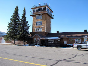 Photo: Watson Lake Air Terminal and Flight Service Station. There is not controller in the Tower. It is not used.