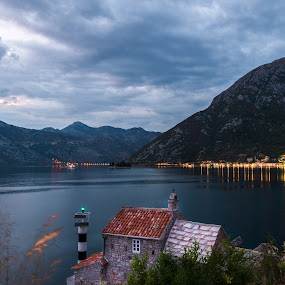 Beacon of light by Andreea Alexe - Landscapes Waterscapes ( clouds, shore, lights, montenegro, mountains, adriatic, lighthouse, trees, sea, #long exposure, kotor, night,  )