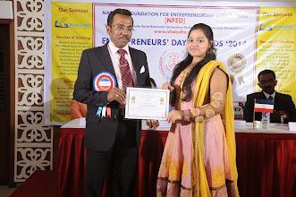 Photo: Prof. Dr. R. Ganesan, Chairman, NFED Issuing Certificate of Appreciation To Programme Anchor,  Ms. S. Priyadarshini, II Year ECE, Meenakshi Sundararajan Engineering College, Chennai