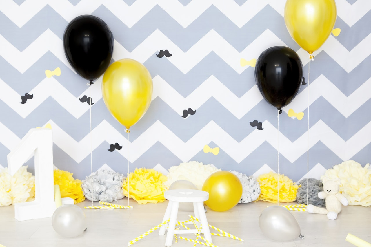 Birthday wall stickers of bows and mustache by Pixabay from Pexels.