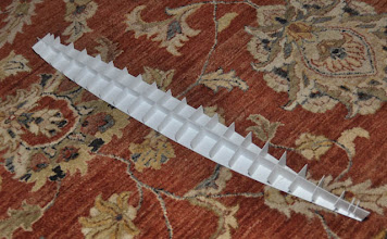 Photo: Modeler's Nightmare: an N-Scale skeleton! Just carve the thing!  Actually, for one master of a Fletcher class destroyer, this 20-section spine ensures an accurate hull profile. As my molding and casting skills improve, this hull becomes attractive as a hull-only option in 1:160, with a scored styrene kit for the superstructure.
