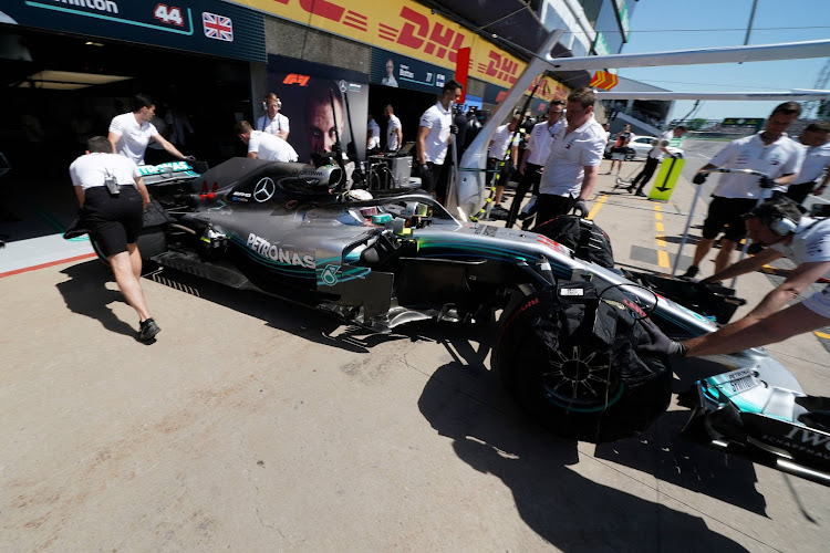 Mechanic pull the car of Lewis Hamilton into the garage at Circuit Gilles Villeneuve during a practice session for the F1 race in Montreal, Quebec, Canada, June 8, 2018.