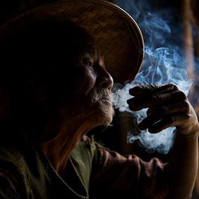 enjoyment by Mike Mulligan - People Street & Candids ( myanmar, smoking, old man, close up, shadows,  )
