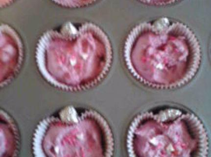 Divide into cupcake lined pans, I sprinkled few valentine jimmies on. Bake on 350...